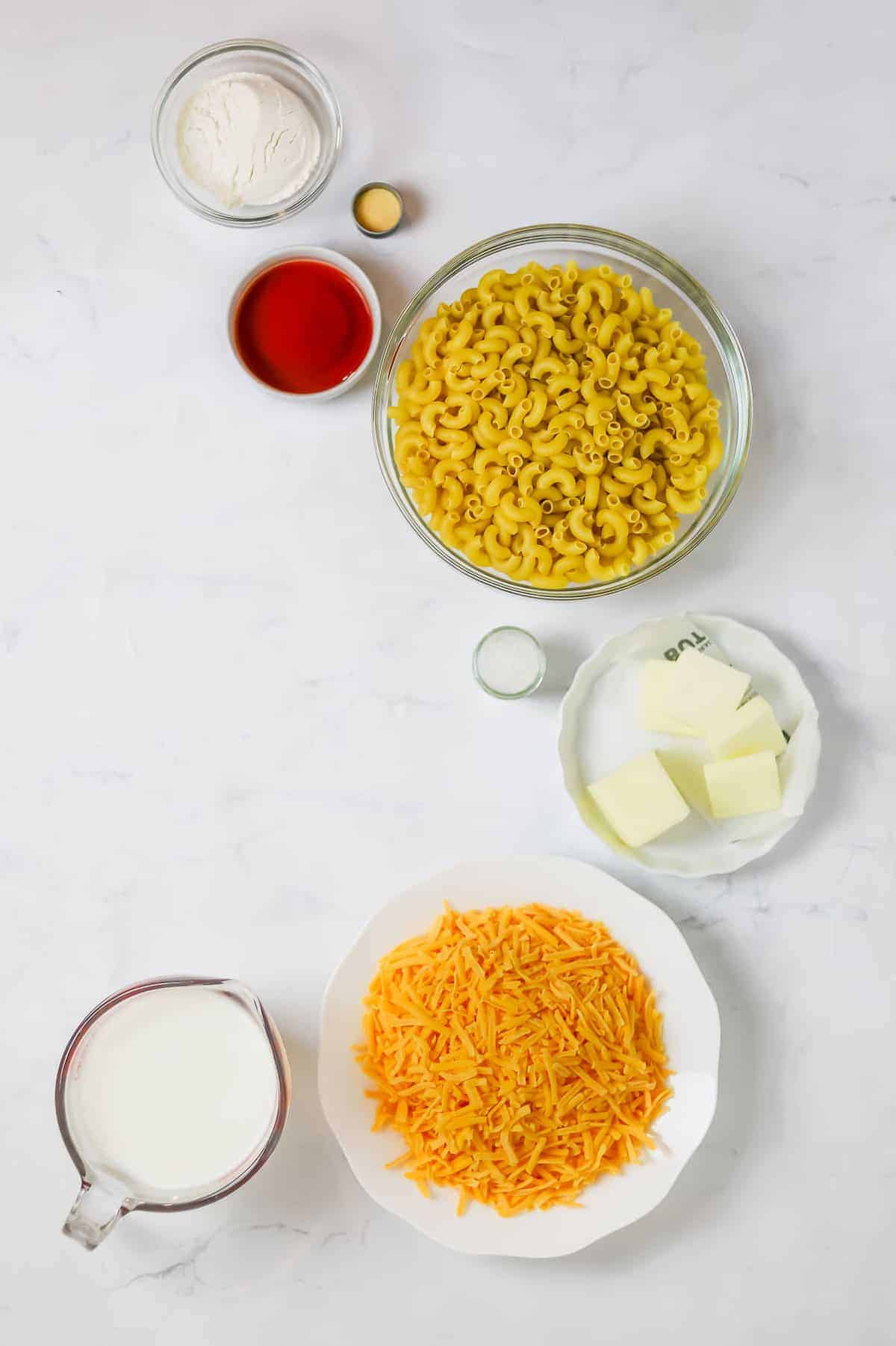 mac and cheese ingredients in bowls, ready to be mixed together