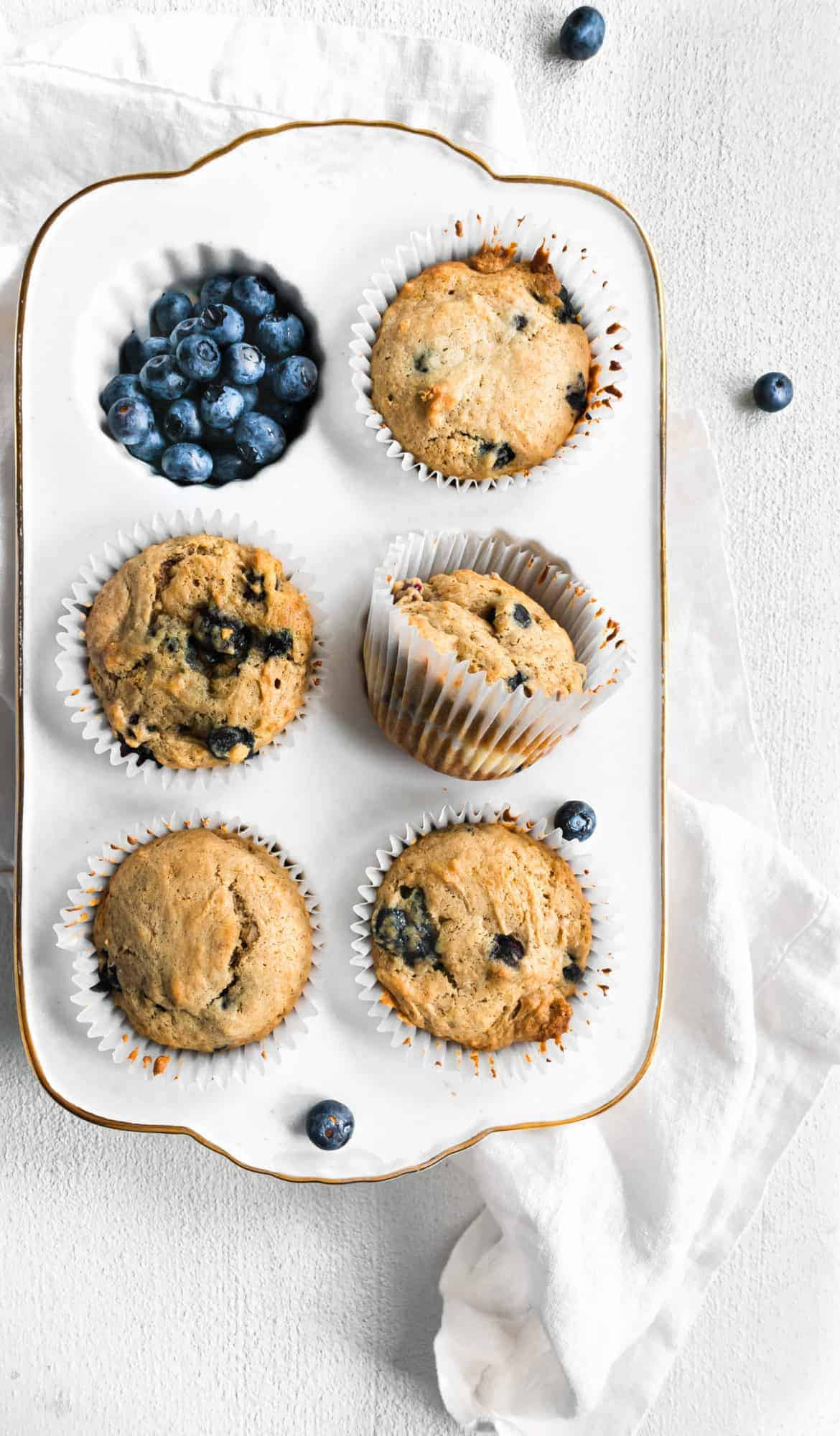 cooked muffins in muffin tin with blueberries
