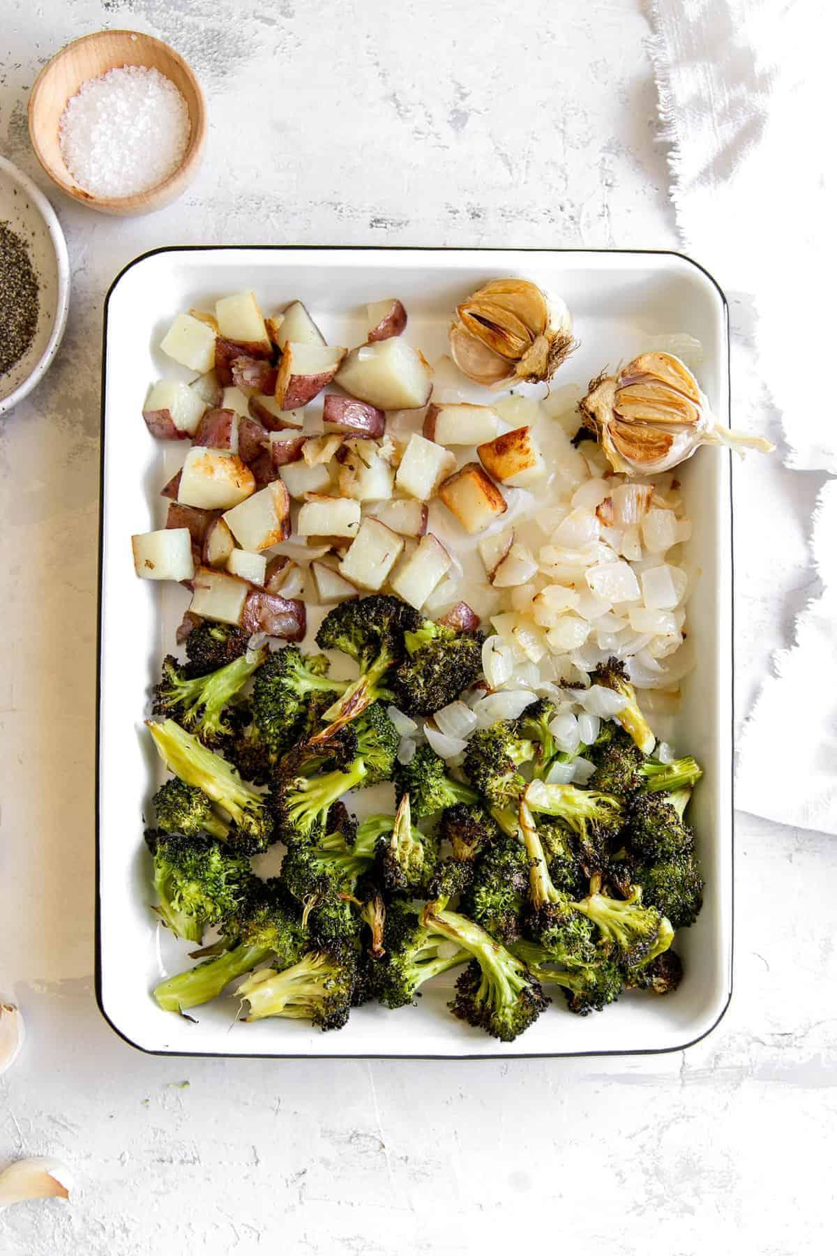 Roasted vegetables in a roasting pan.