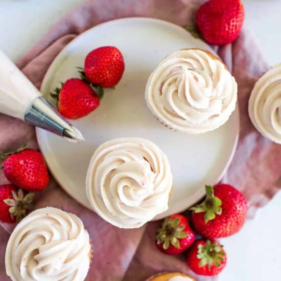strawberry cream cheese frosted cupcakes on a plate