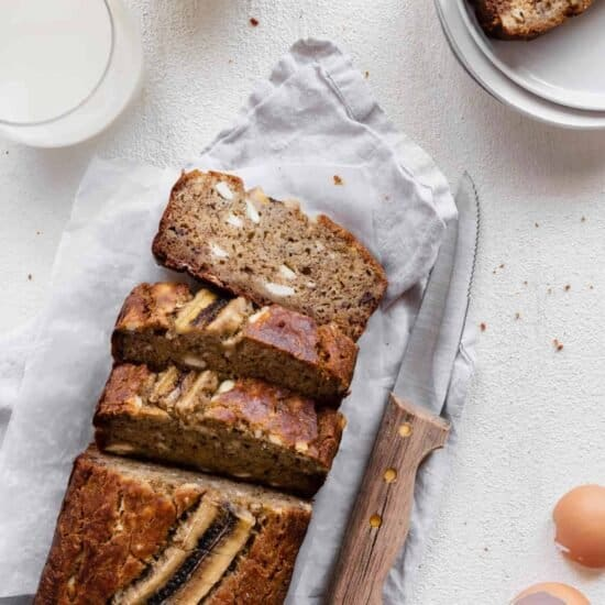 cream cheese banana bread cut up with knife