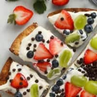 Easy fruit pizza on a cutting board.