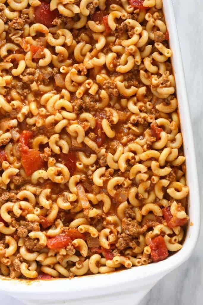 noodles and tomato sauce in casserole dish