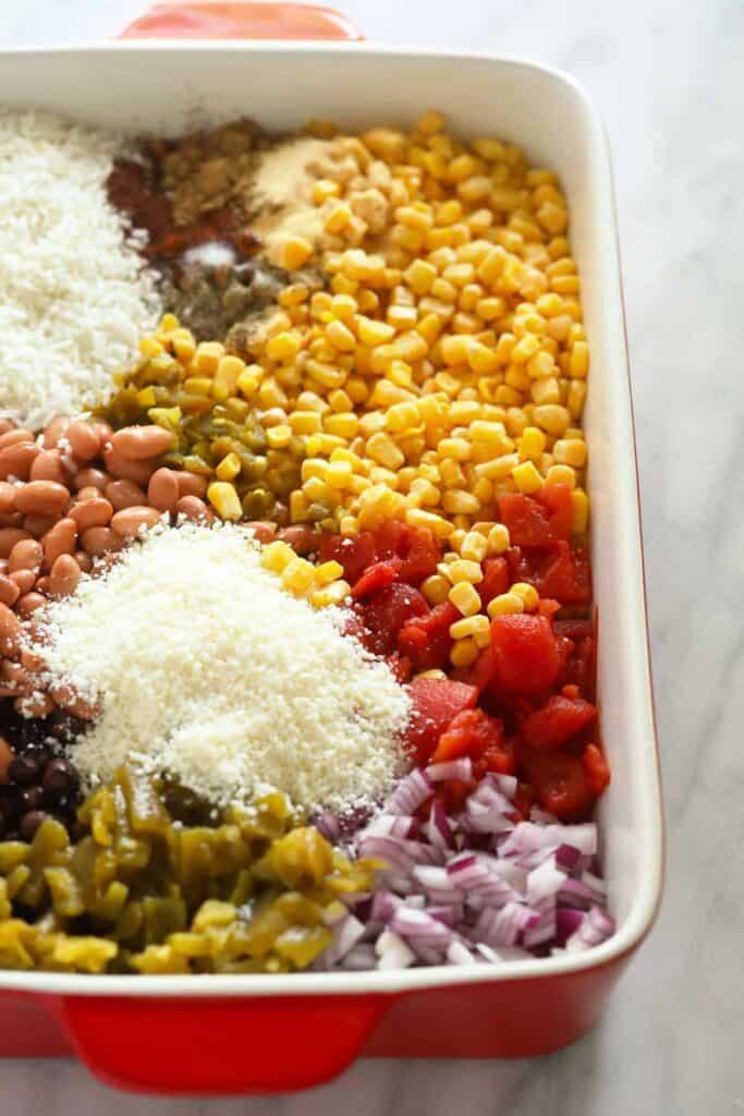 mexican street corn casserole ingredients in a casserole dish