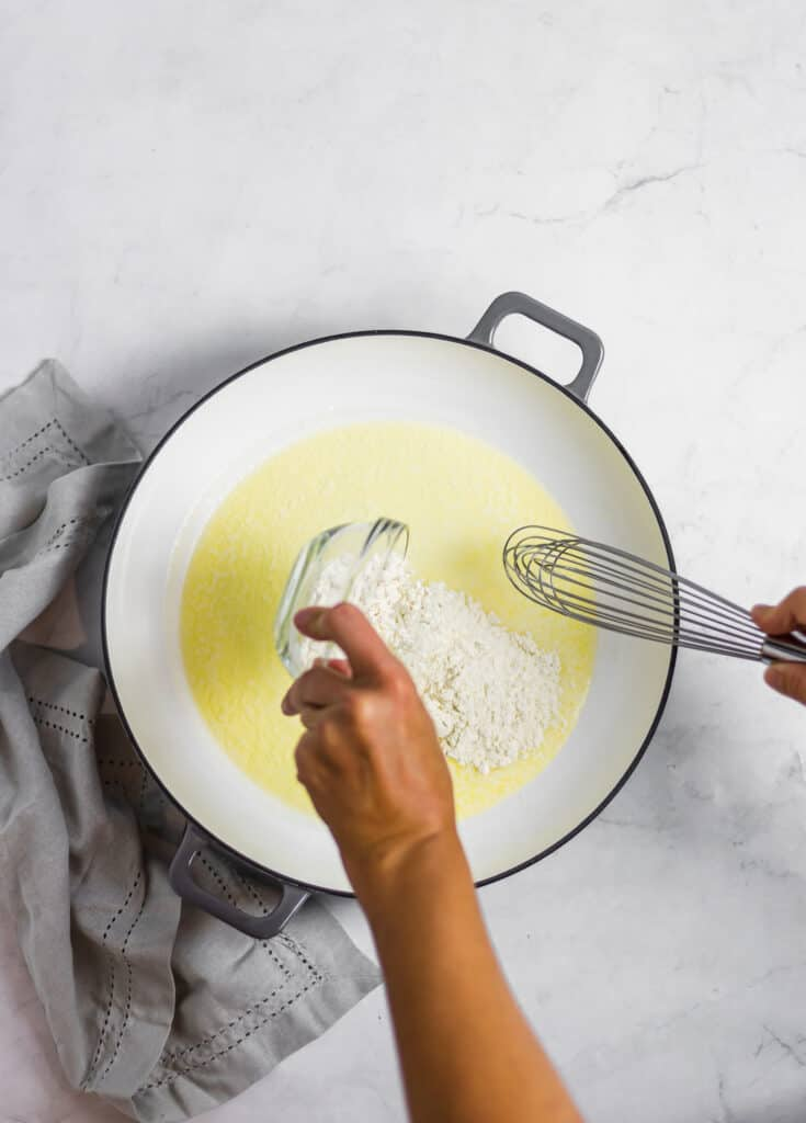 whisking together butter and flour