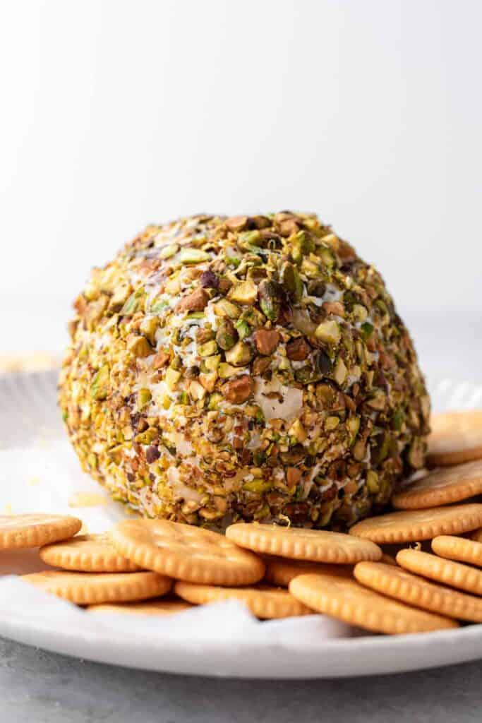 festive cheese ball covered in pistachios