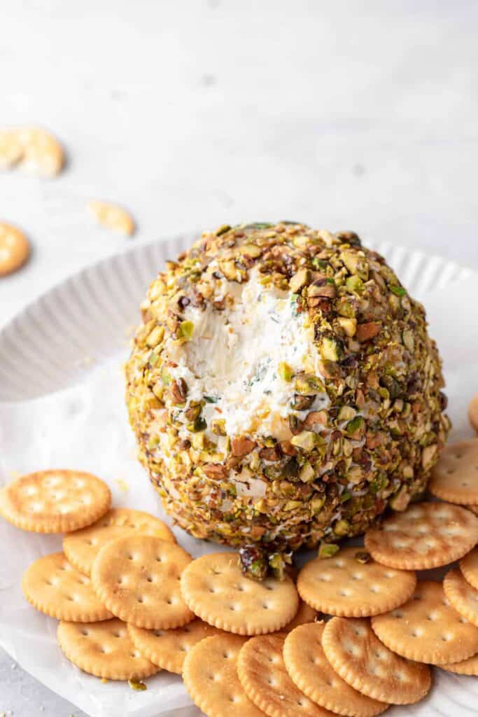 cheese ball with a chunk dipped out of it