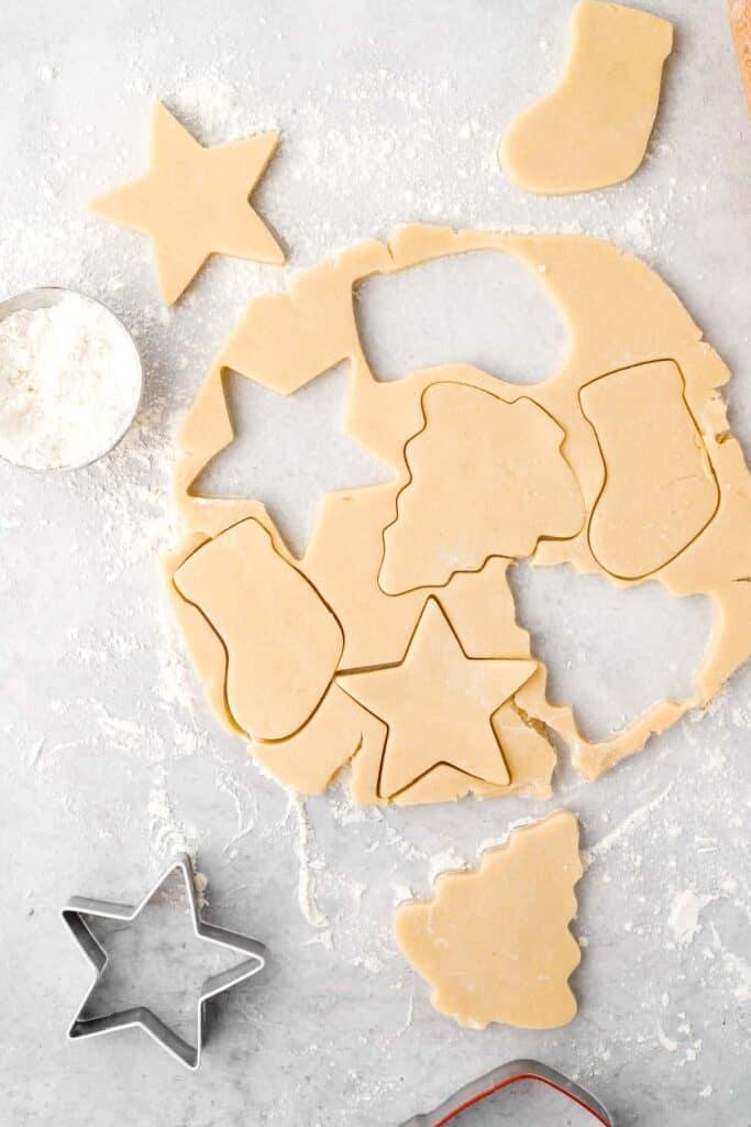 cookie cutters in dough