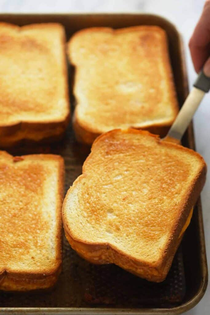 sheet pan grilled cheese sandwiches baked to golden brown perfection