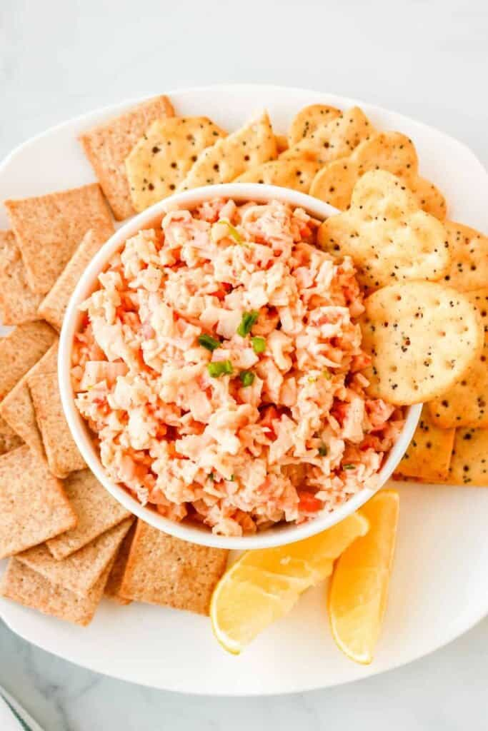 Crab dip in a bowl surrounded by crackers.