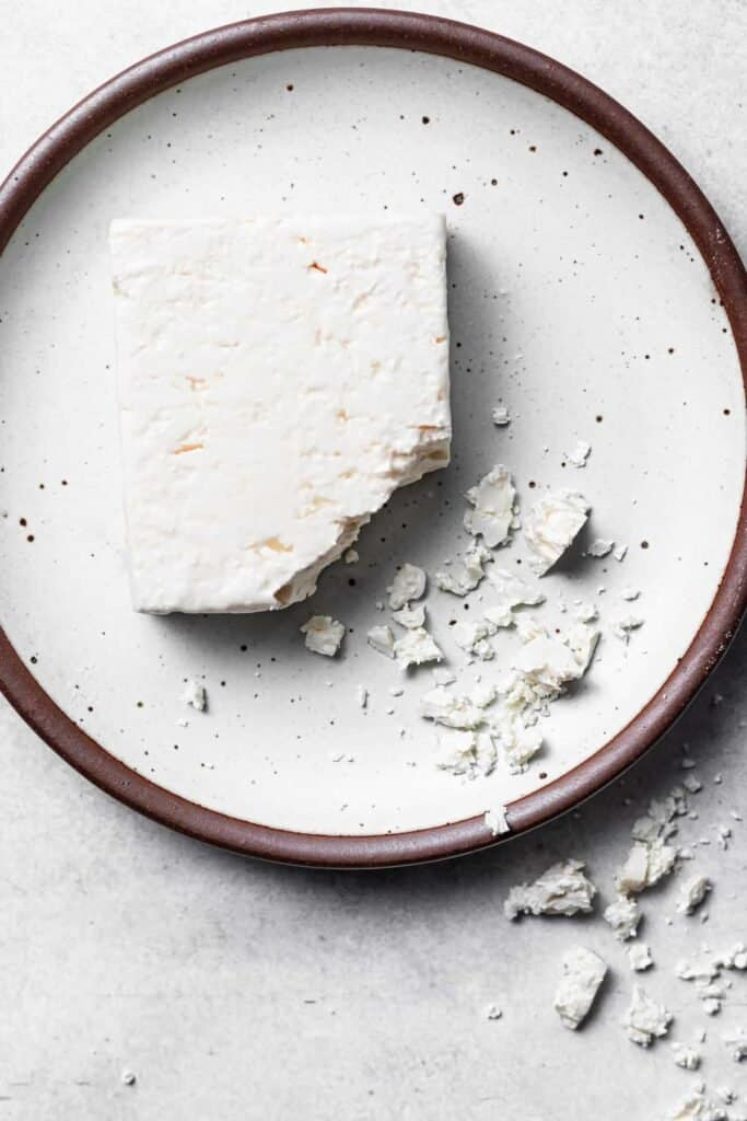 block of feta cheese on plate