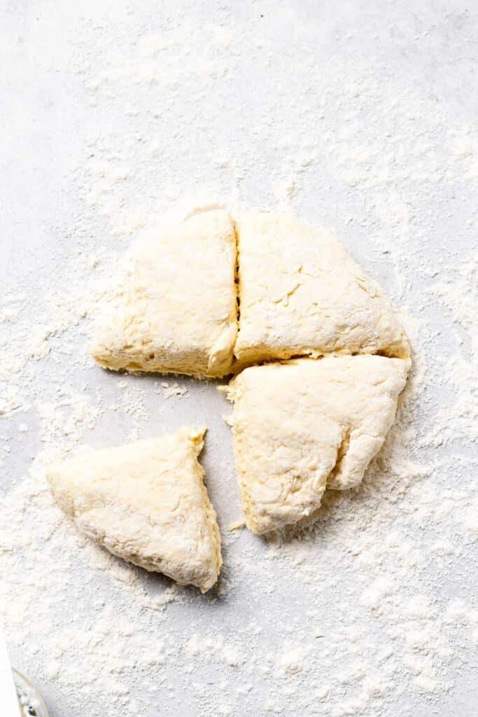 ricotta gnocchi dough split into fourths