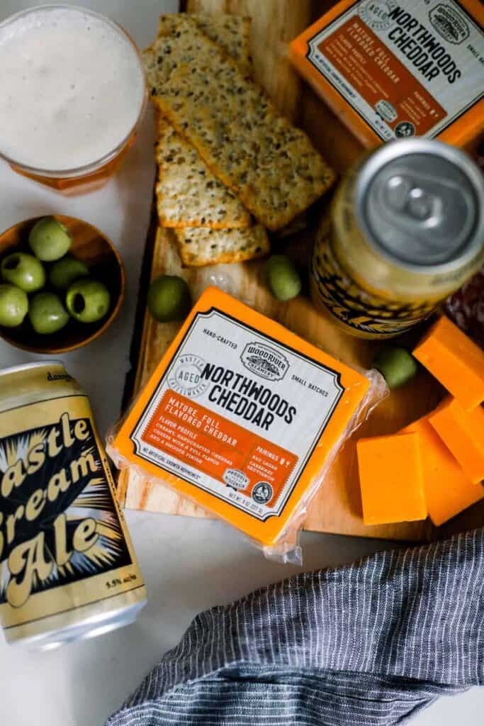 cheddar cheese and olives paired with a delicious cream ale
