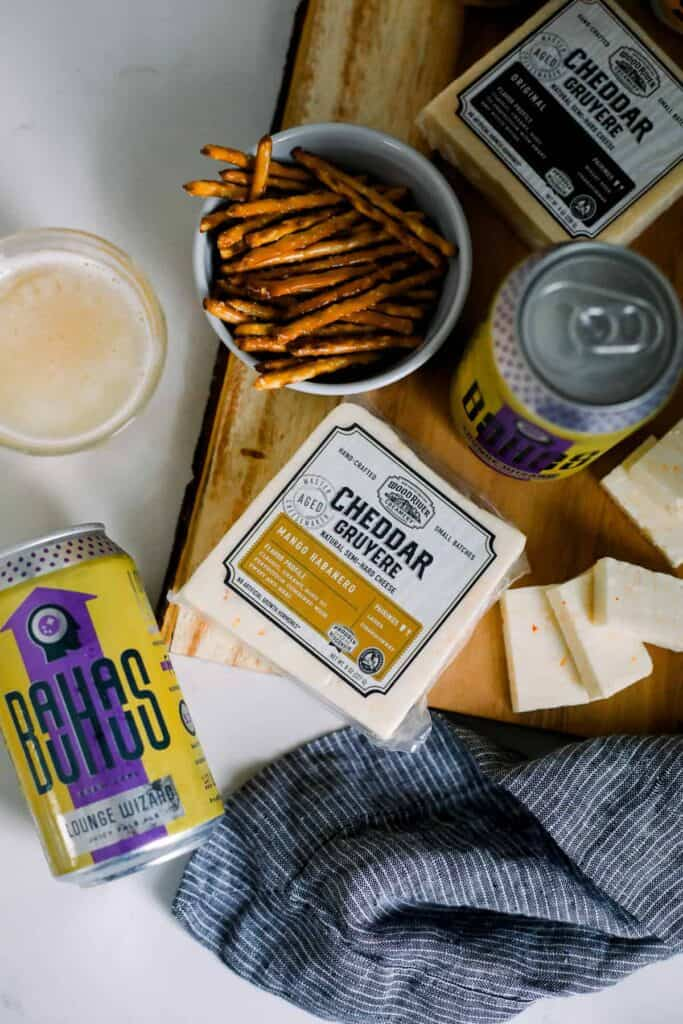 beer and cheese and pretzel pairings on a cutting board