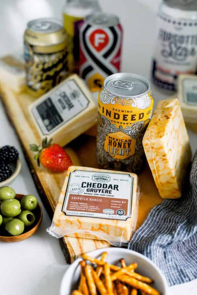beer and cheese pairings on a cutting board