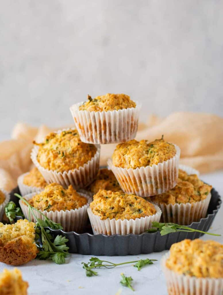 savory cheese muffins stacked and ready to be eaten