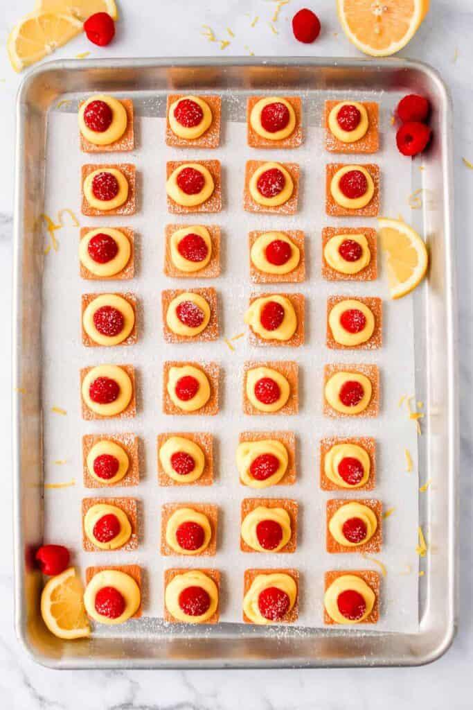mini lemon cheesecakes on baking sheet