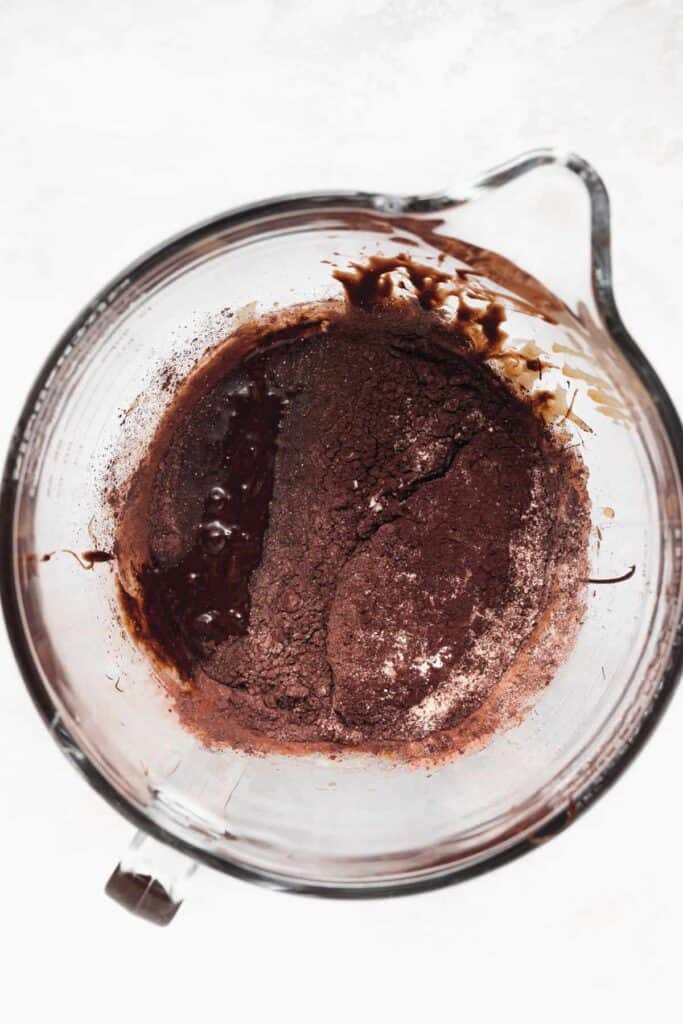 Chocolate brownie batter in a bowl.