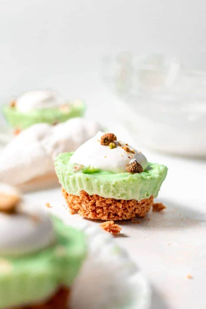 pistachio pie cup with a graham cracker crust, ready to be enjoyed
