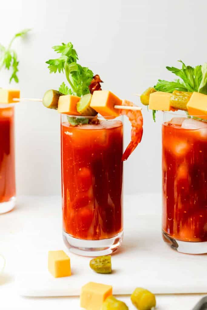 bloody mary skewers on top of a bloody mary