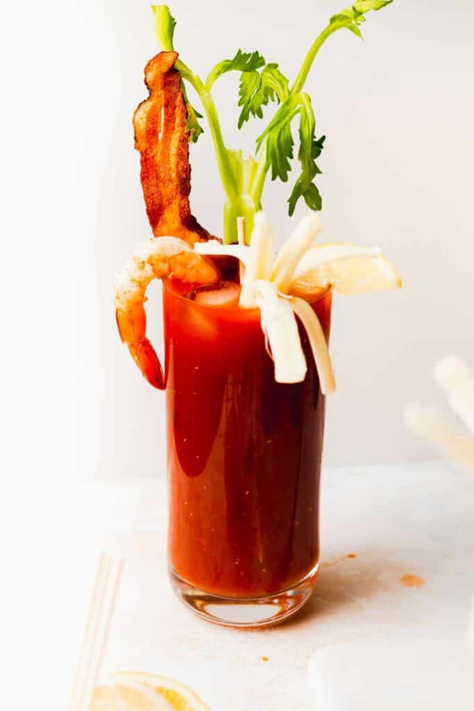 bloody mary in a glass topped with fun accoutrements