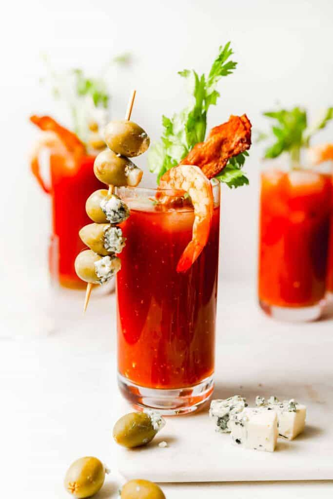 blue cheese stuffed olives on a skewer for bloody marys