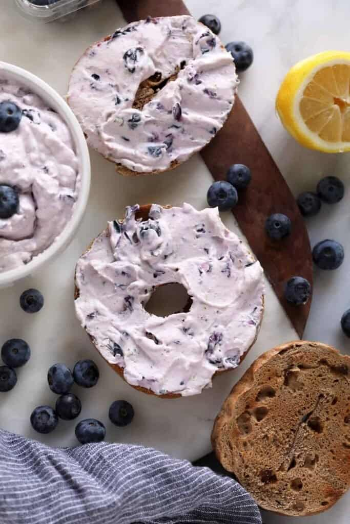 A bagel with blueberry cream cheese.