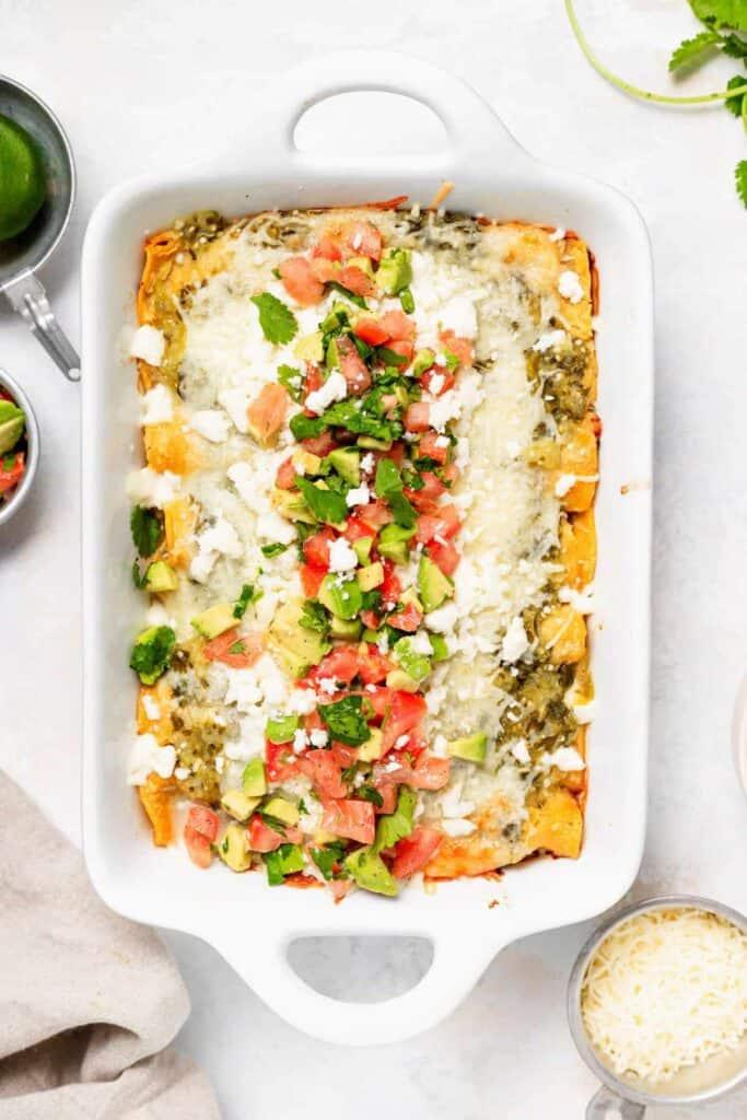 A casserole dish of enchiladas.