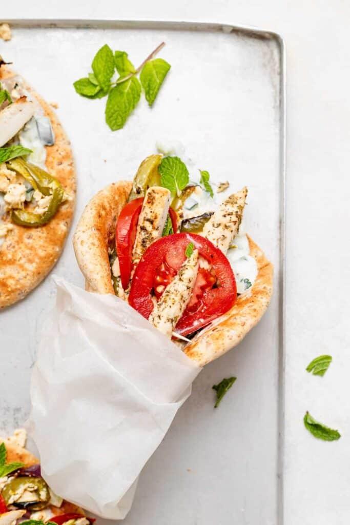 chicken gyros with feta and a greek yogurt sauce.
