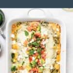 Homemade chicken enchiladas in a casserole dish.