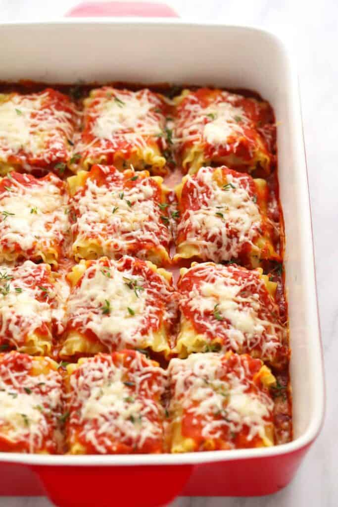 Baked Kale Lasagna Roll ups in a casserole dish.