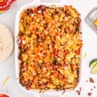 Taco lasagna in a casserole dish.