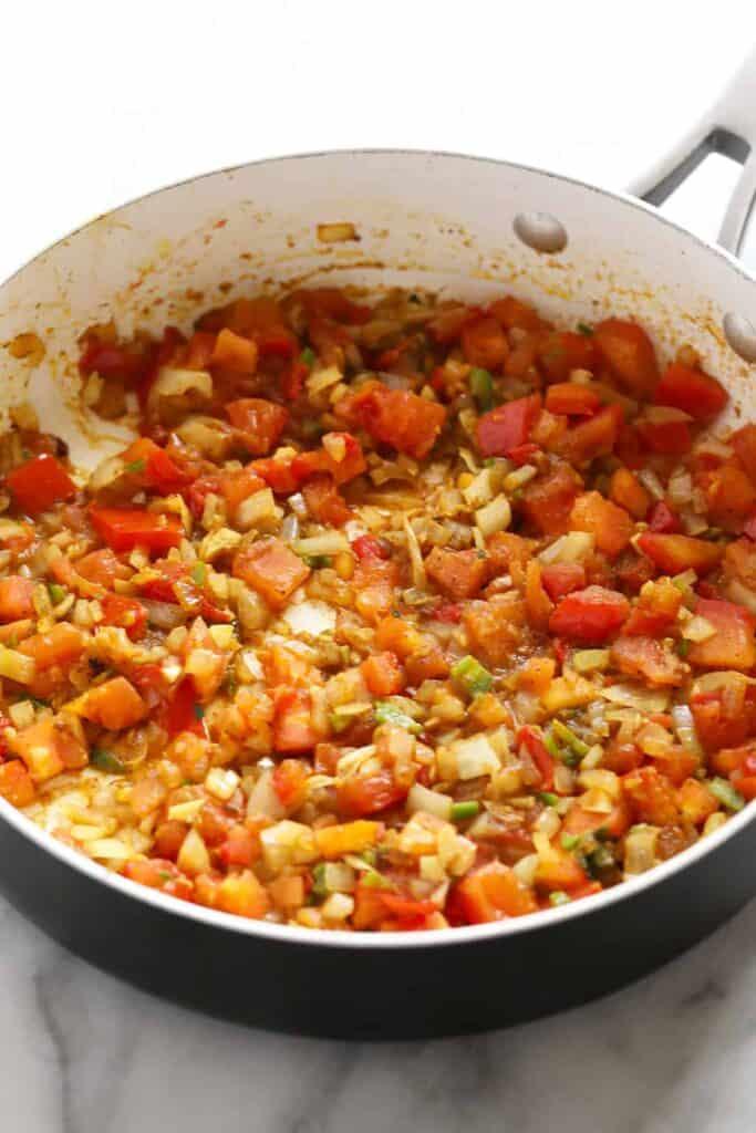 Palak paneer ingredients in a saute pan.
