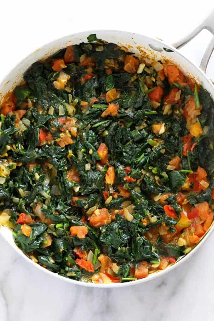 Spinach and other ingredients in a pan.