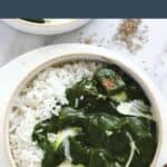 Palak paneer in a bowl with rice.