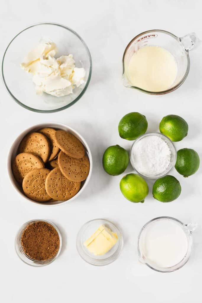 A photo of cream cheese, sweet and condensed milk, crackers, sugar, and limes.