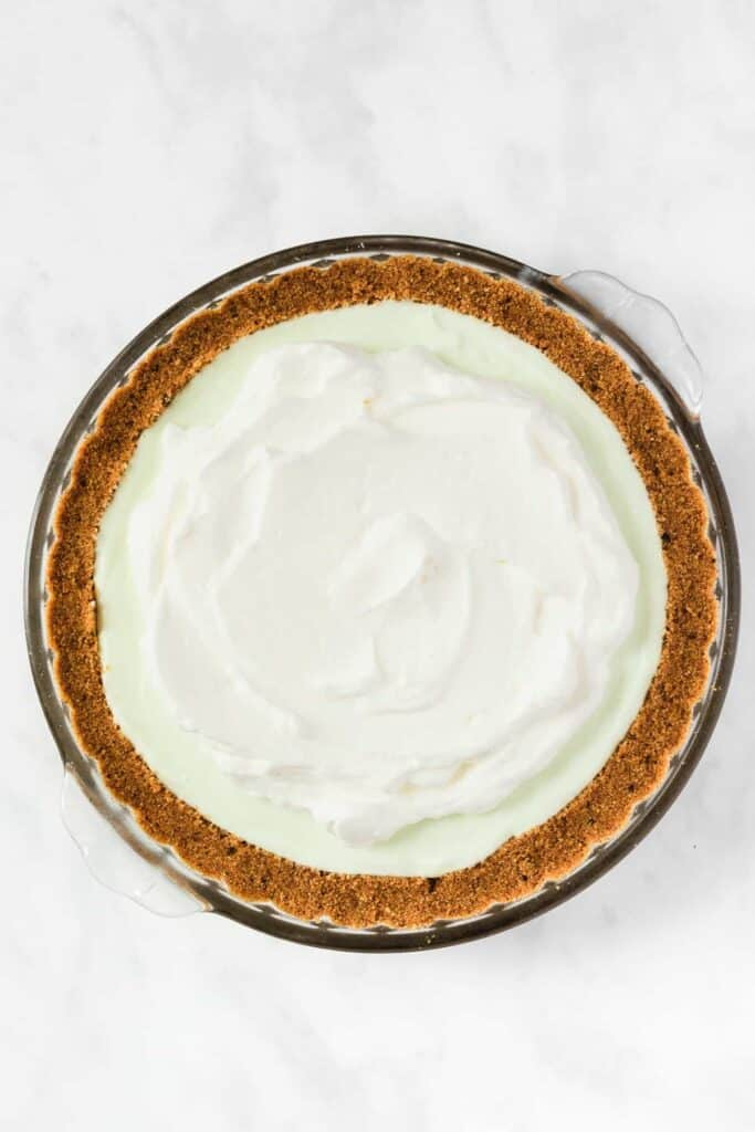 Key Lime Pie with whipped topping ontop.