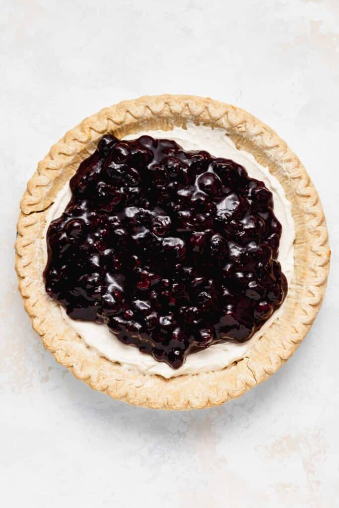 Blueberry topping on cream cheese filling.