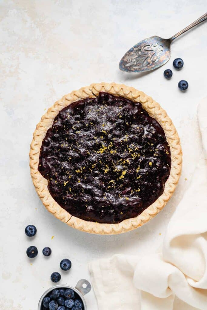Blueberry cream cheese pie in a pie pan.