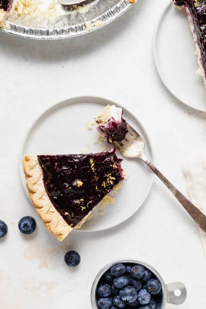 Blueberry cream cheese pie on a plate.