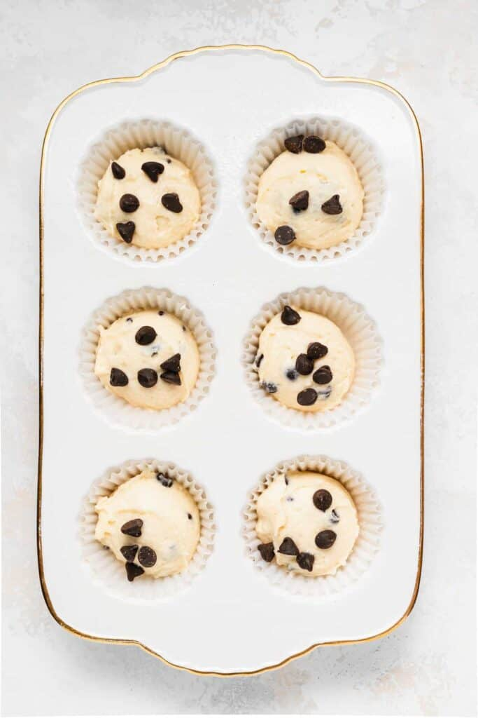 chocolate chip ricotta muffins in a muffin tin ready to be baked