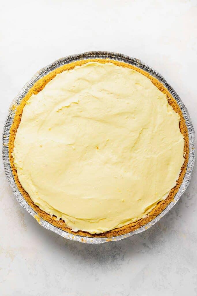 Cream cheese lemonade pie in a graham cracker crust.