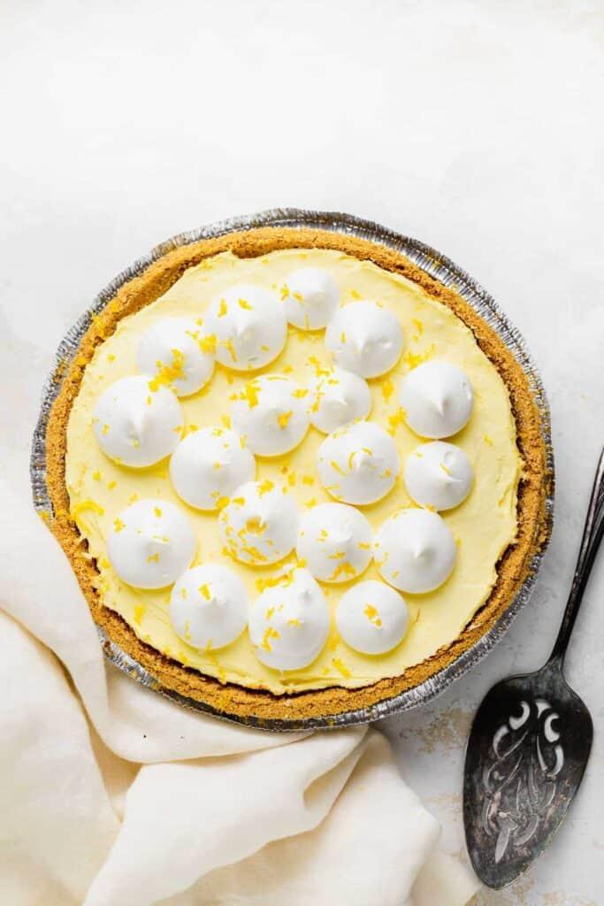Cream Cheese Lemonade pie with whipped cream and fresh lemon zest.