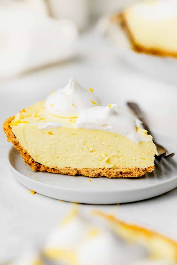 Cream cheese lemonade pie on a plate.