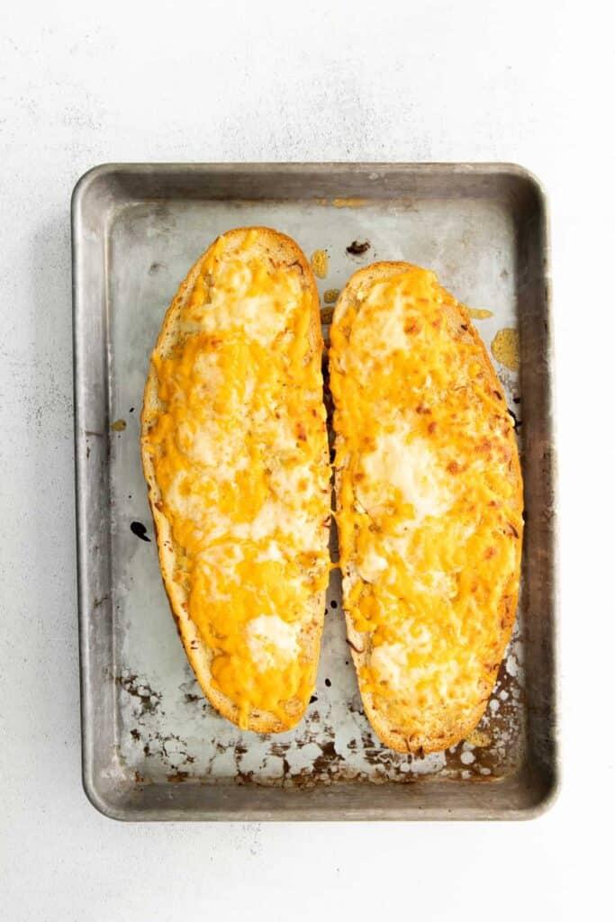 Baked garlic bread on a baking sheet.