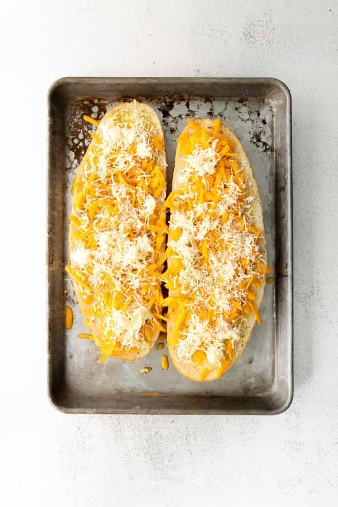 Garlic bread with cheese before you bake it!