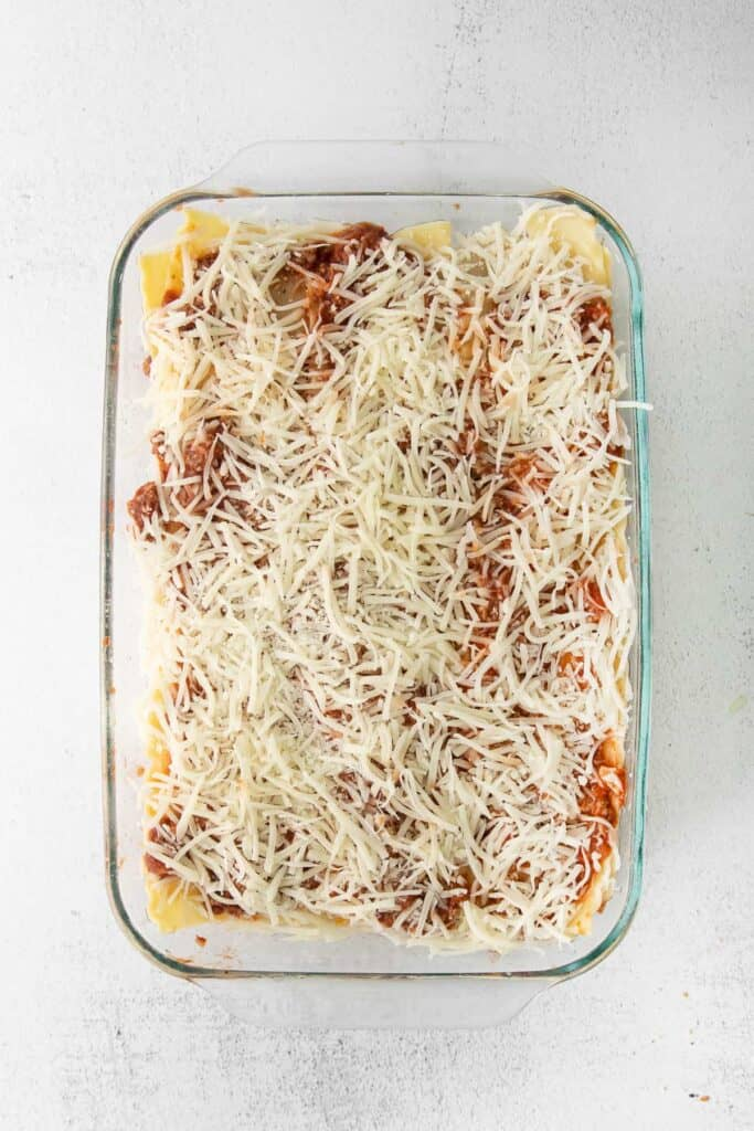 Lasagna recipe sprinkled with cheese.