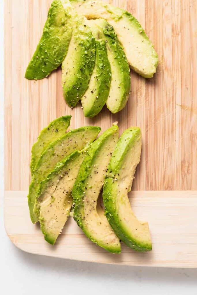sliced avocado on cutting board