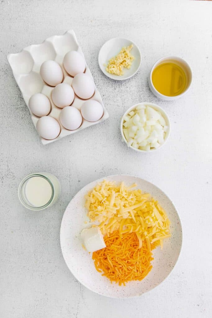 ingredients for four cheese frittata ready to be mixed together and baked