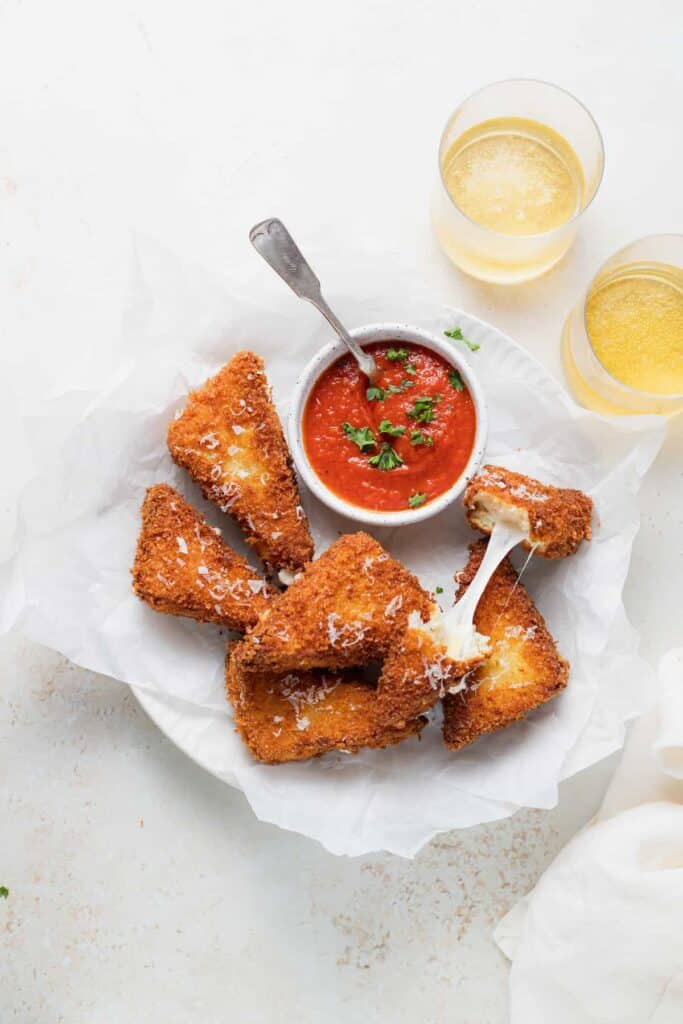 mozzarella in carrozza sandwich triangles with marinara dipping sauce, ready to be served